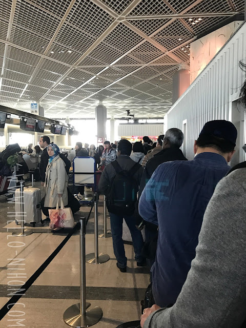 Waiting line at the airport for Asiana Air