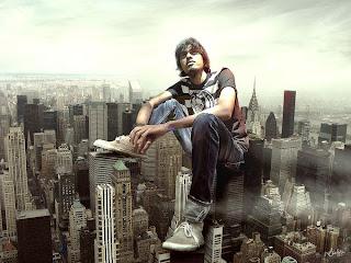 fotomontaje de gigante sentado en edificios