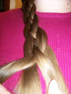 Four strand basket plait or braid in progress.