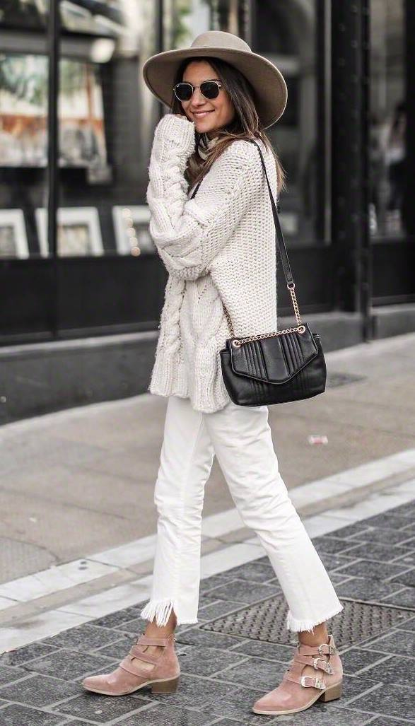 what to wear with a hat : white knit sweater + bag + jeans + boots