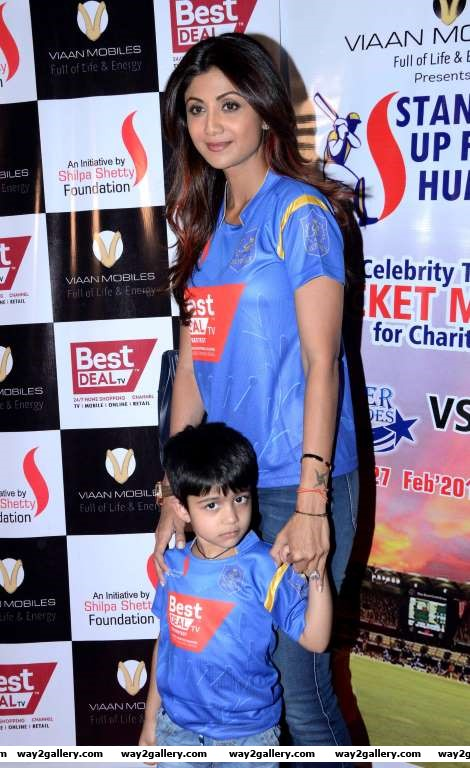 Shilpa Shetty and son Viaan pose for photographers during a celebrity charity cricket match hosted by the Shilpa Shetty Foundation