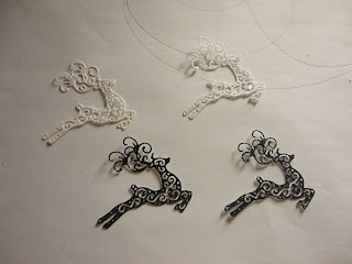 Leaping reindeer die cuts, in black and white glitter card