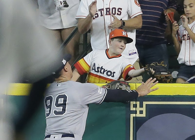 Young Astros fan reaches for Correa's