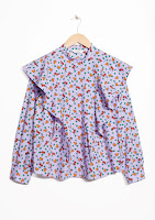 http://www.stories.com/be/Ready-to-wear/Blouses_Shirts/Frilled_Blouse/114066402-0559456001.2