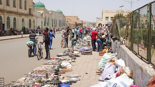 Behind the mosque is the souvenir and household utensils market