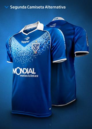 cf849d19652 O Vélez Sarsfield apresentou seu novo terceiro uniforme para a disputa do  Campeonato Argentino em 2012. Fabricada pela Topper, a camisa possui o  tradicional ...
