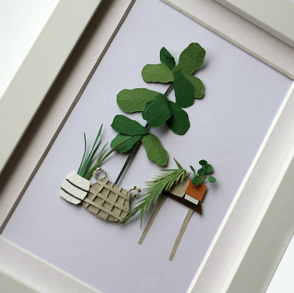 framed, cut paper house plant scene with table and potted plants