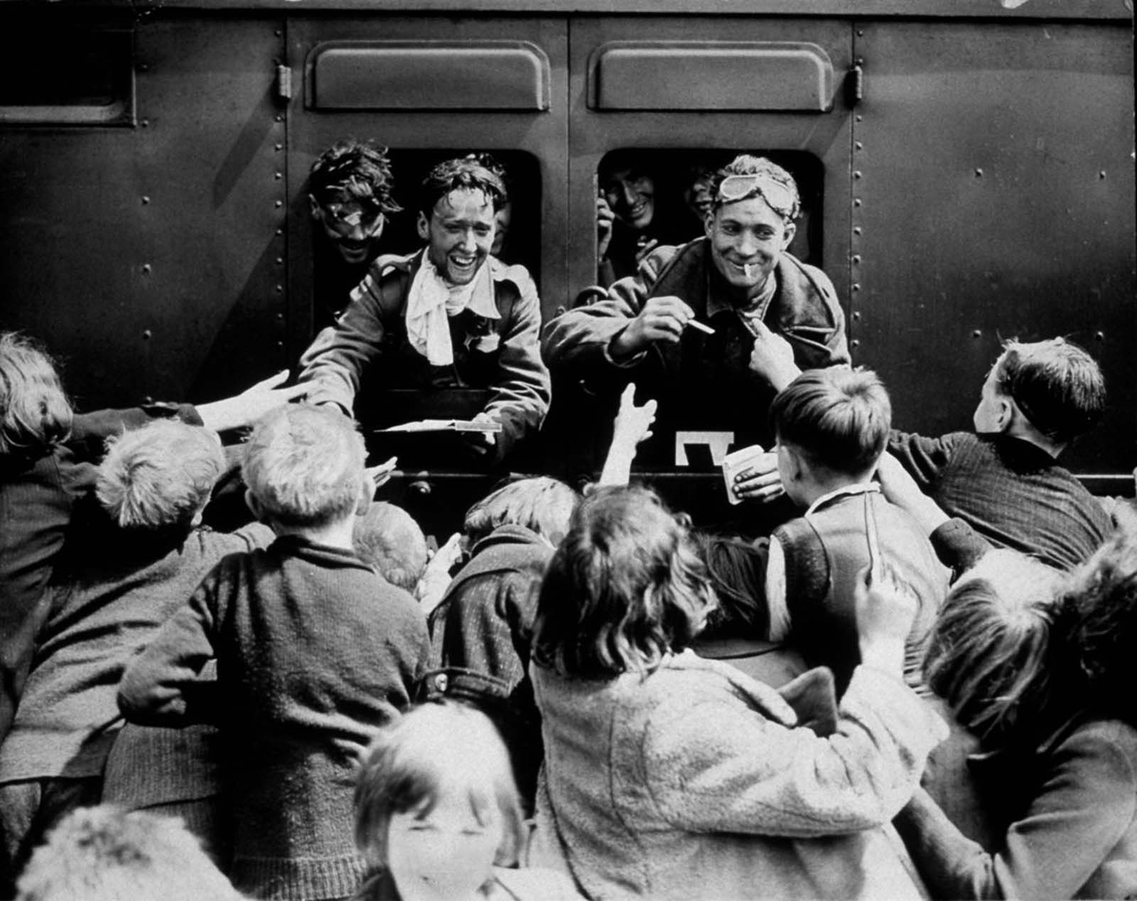 Children greet returning British soldiers.