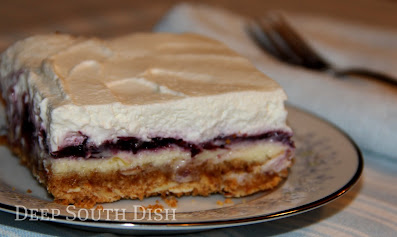 Another terrific layered dessert, made with a graham cracker and nut crust, creamy cream cheese filling, topped with a blueberry pie filling and finished with homemade whipped cream. Heaven indeed!