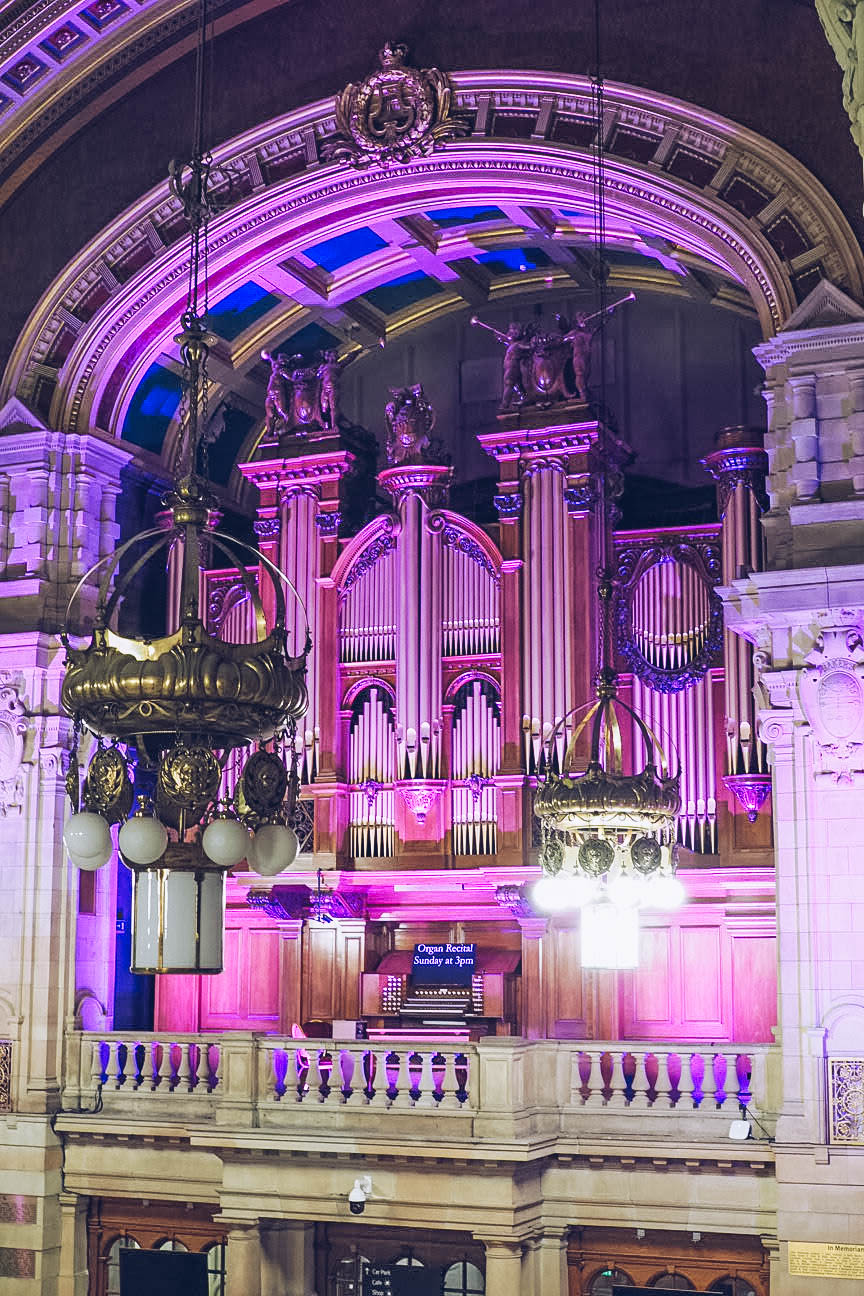 Pipe organ lit up in purple lights in Kelvingrove