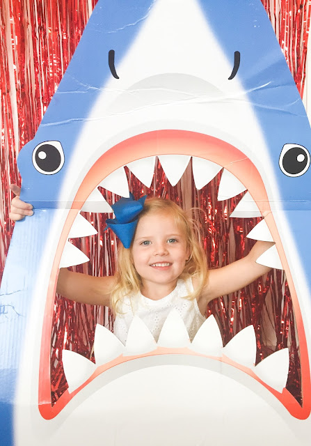 Create a shark photo booth in just a few easy steps. Great for a shark party!