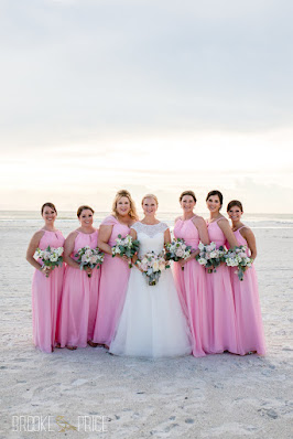 bride with bridesmaids in bright pink dresses