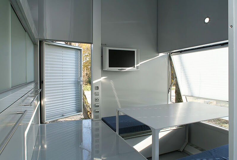 03-TV-and-Dining-area-M-CH-Sustainable-Micro-Compact-Home-Architecture