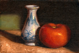 Oil painting of a small white porcelain vase with blue patterns beside a red tomato.