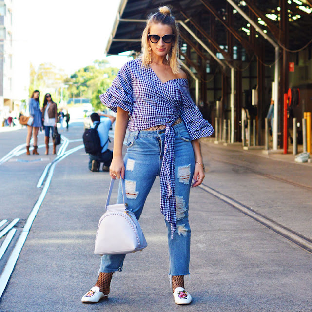 mercedes-benz street style outfit gingham off shoulder wrap blouse and distressed jeans