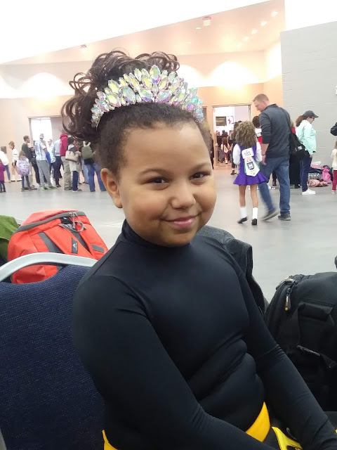 Irish dancer showing off her tiara at Mid America Oireachtas in Louisville, Kentucky