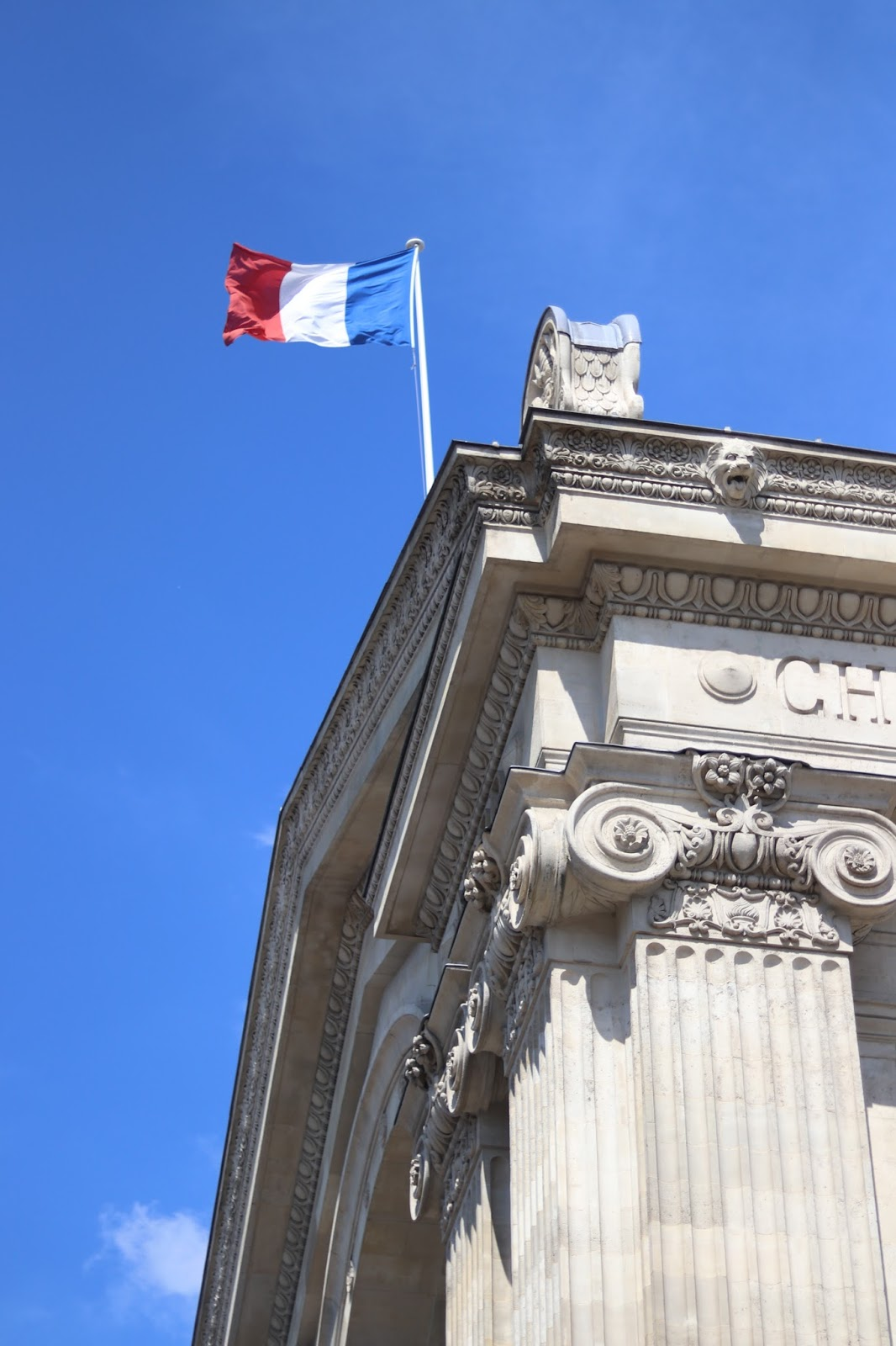 French Flag blowing in the wind against blue sky, Paris, France