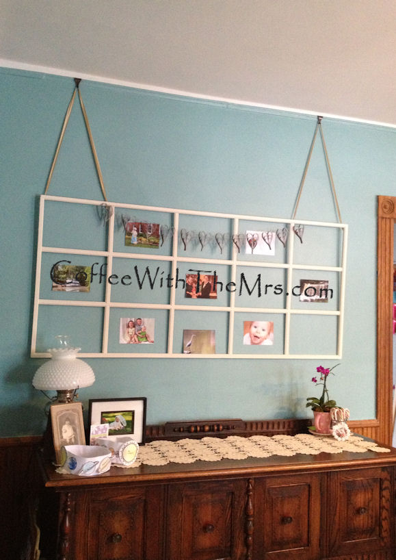 A Paper Heart Garland And A Glass Panel Door Frame Is Now