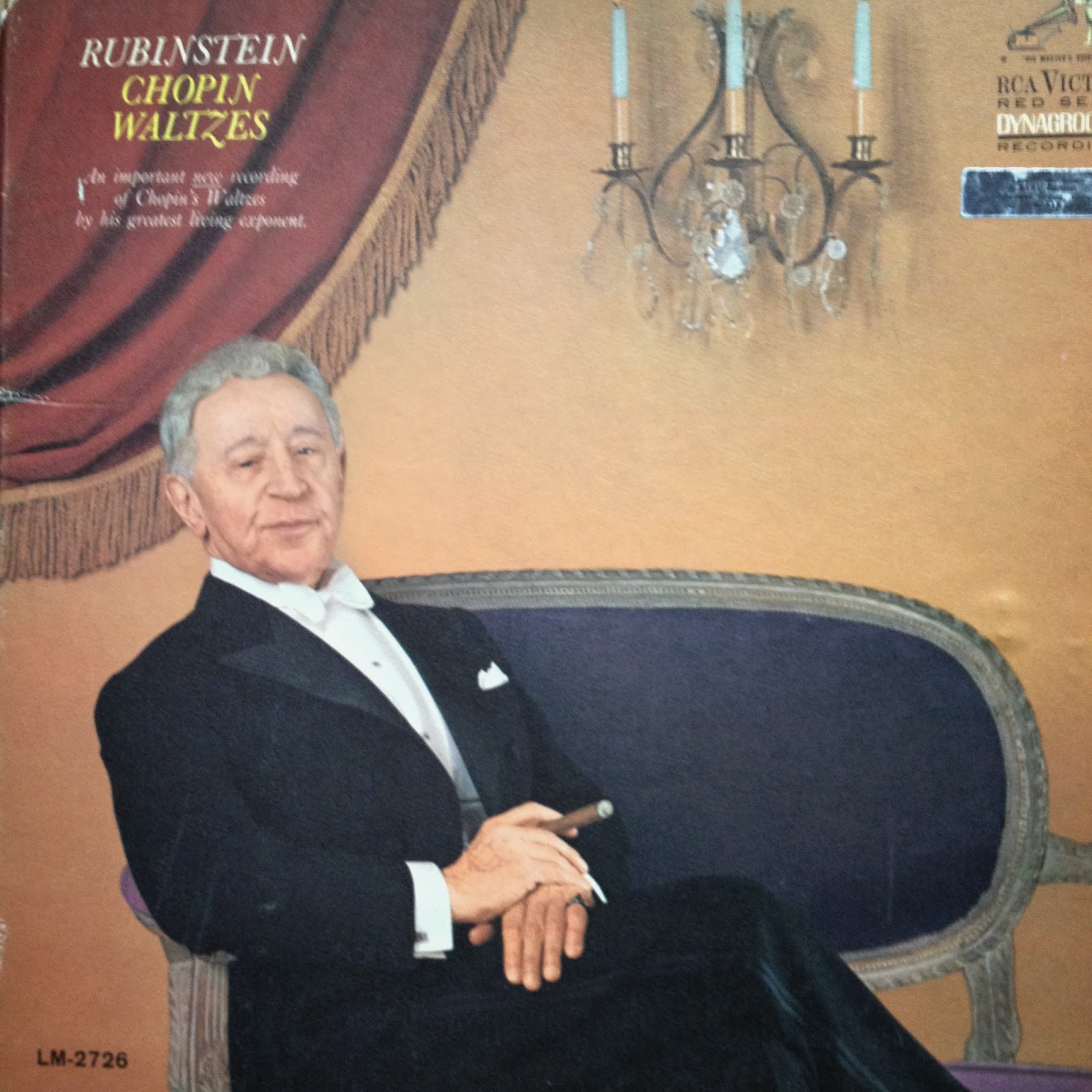 LP cover of a dapper Arthur Rubinstein, master of Chopin, relaxing with a cigar