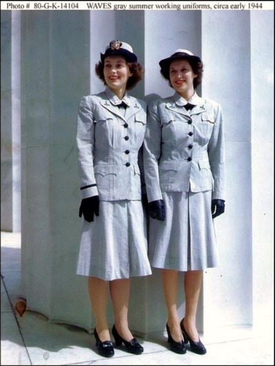 Two women posing in Mainbocher designed U.S. Navy Waves Uniforms