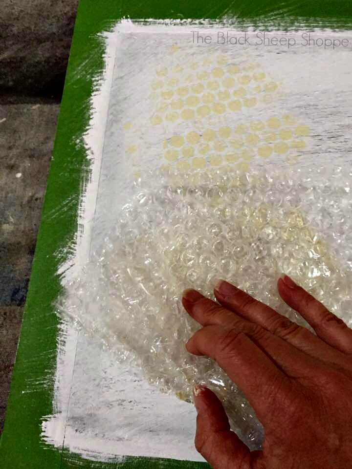 Press the bubble wrap onto the board.