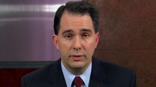 Walker praises apprentice President's Muslim ban