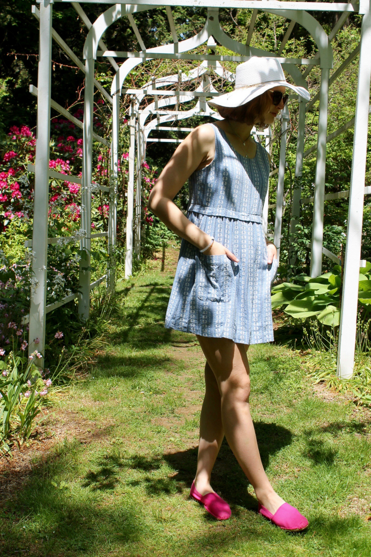 Short blue and white summer dress worn with a large wide rimmed white summer hat
