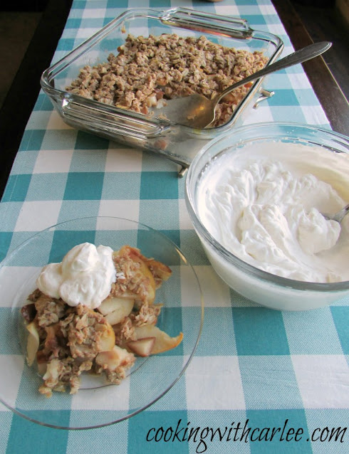 apple crisp with fresh whipped cream on top