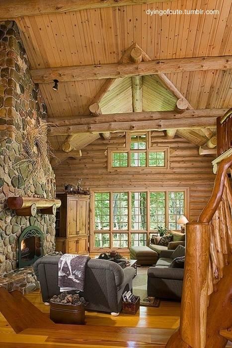 Hogar de leños hecha de piedra y troncos rústicos
