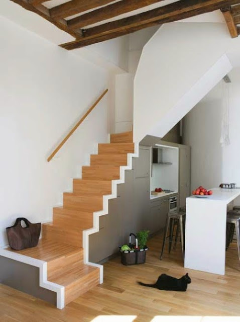 space saping concrete staircases with hiddem kitchen