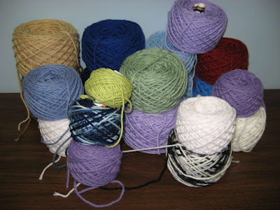 Neat newly-wound cakes of yarn