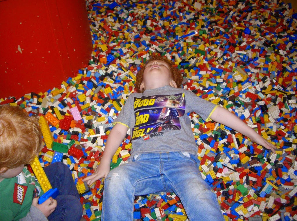 LEGOLAND Discovery Centre Manchester child lying in LEGO