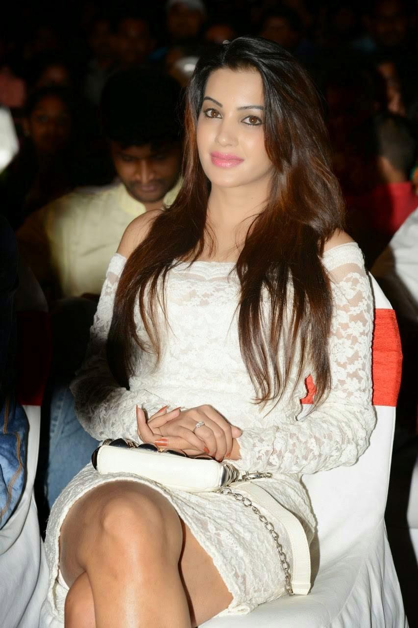 , Actress Diksha Panth Crossleg Sitting Pics in White Dress from Event