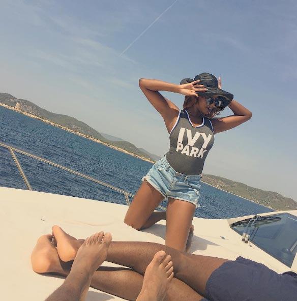 Video: Billionire daughter DJ Cuppy & her man cools off in Ibiza, Spain