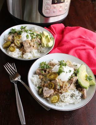 pork burrito bowls with garnishes in front of instant pot