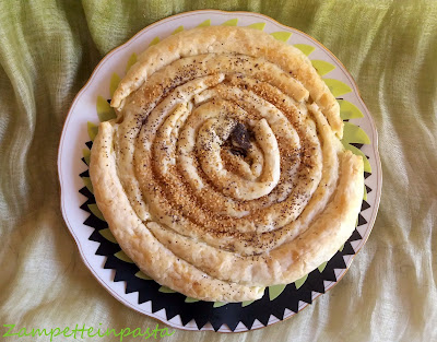 Girella di sfoglia ripiena salata - Torta salata a spirale