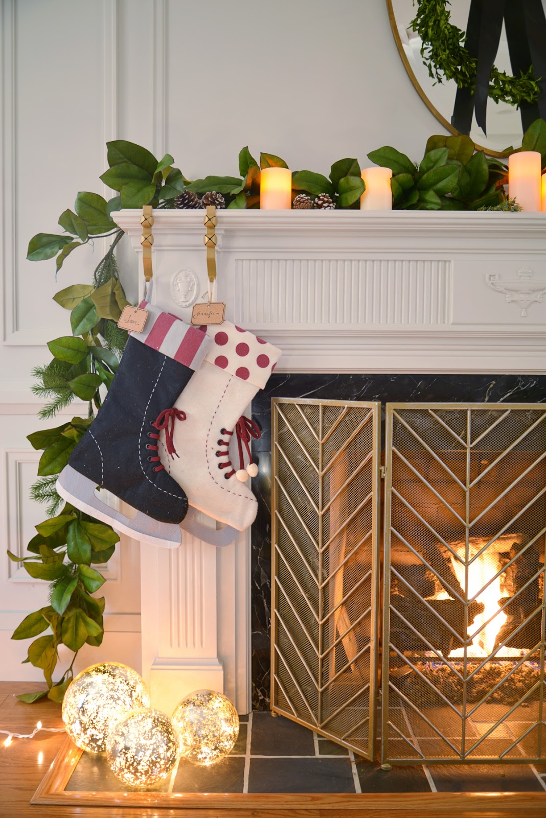 felt stockings on fireplace, magnolia garland