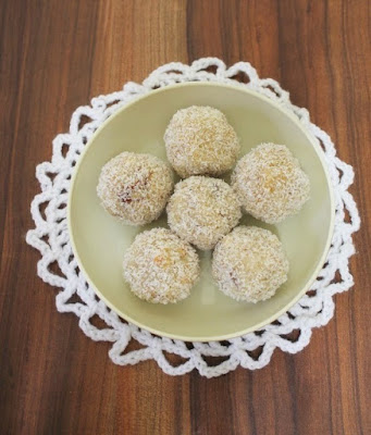 http://www.spiceupthecurry.com/coconut-ladoo-recipe-with-condensed-milk/