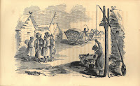 A Russian village scene including a horse-drawn sleigh, a man drawing water from a well, and a group of men dressed warmly and gathered in a circle near several log houses.