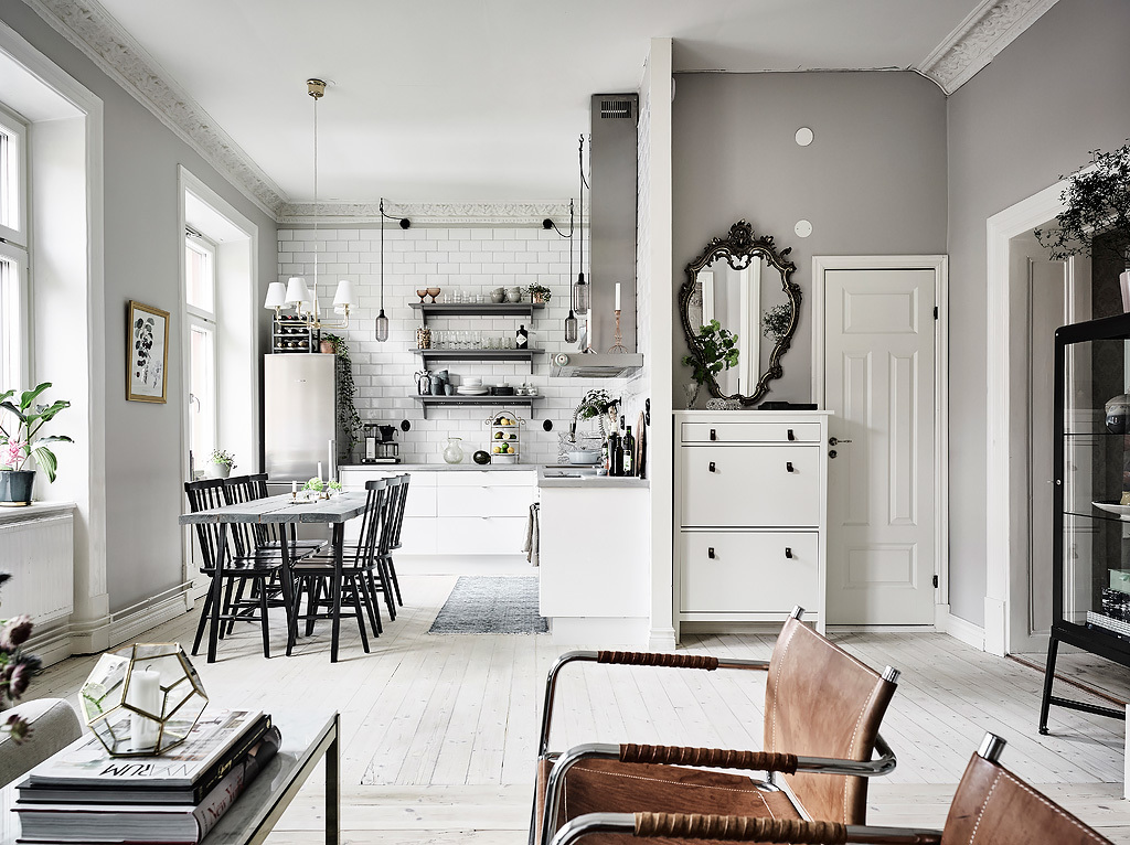 Plan deschis și decor scandinav într-un apartament de 60 m²