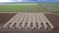Crop preparation by 17 machines (Credit: AP Photo/Andre Penner) Click to Enlarge.