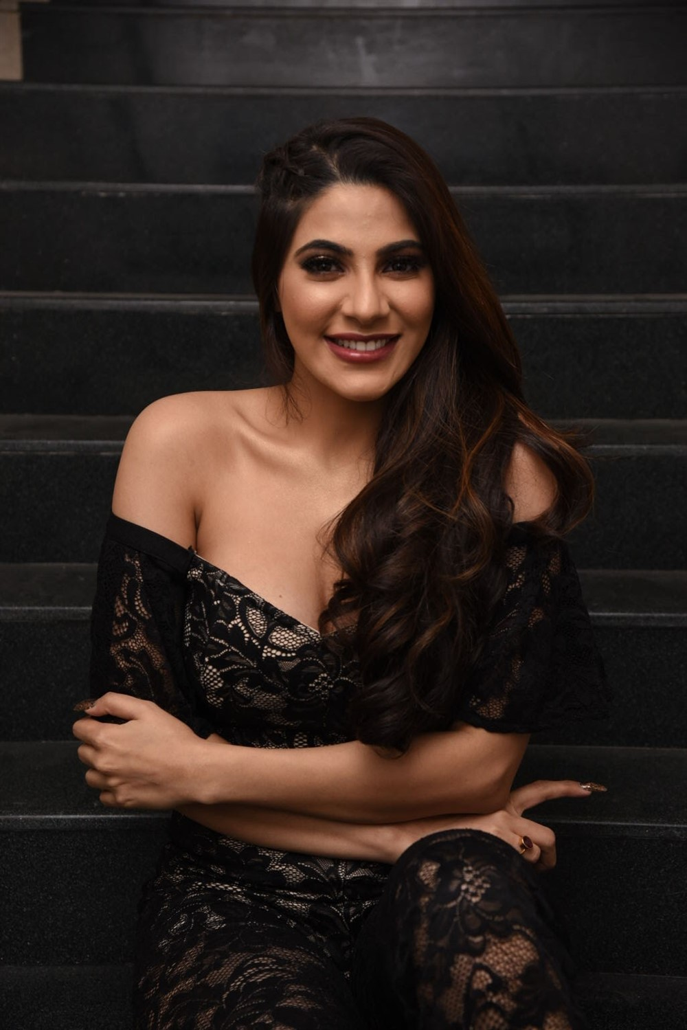 Nikki Tamboli in Deep Neck Sleevless Off Shoulder Gown at Chikati Gadhilo Chithakotudu Movie Pre Release Event at Hyderabad