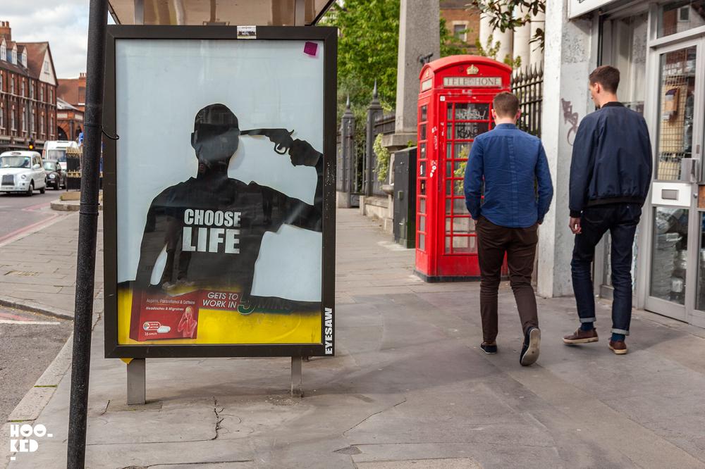 Adbusting with street artist Eyesaw in London, UK Photo© Hookedblog / Mark Rigney