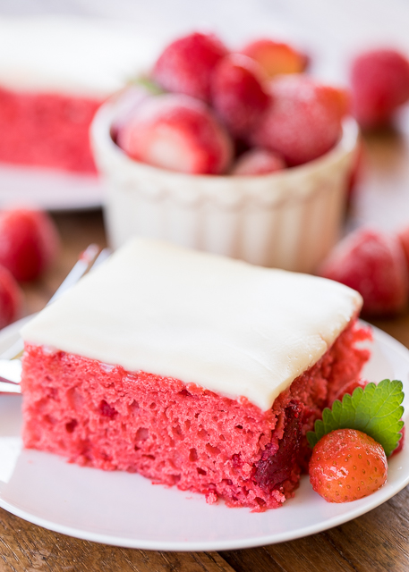 Strawberry Pie Cake - doctored up cake mix with strawberry pie filling and vanilla extract. Topped with a quick homemade white chocolate frosting. This cake is requested for birthday's and potlucks! SO good!