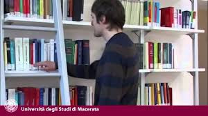 student taking a book in library
