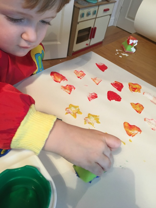 5-minute-games-for-toddler-painting-with-foam-stamps