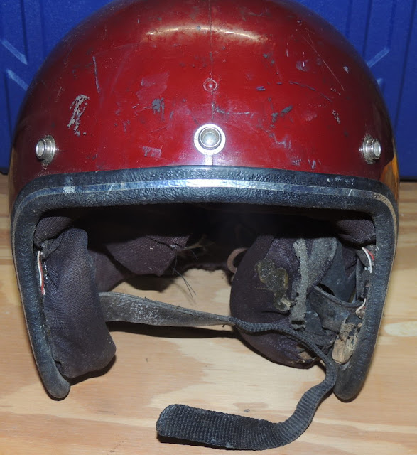 Front view of battered red helmet