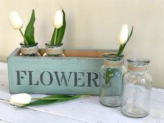 Creating a Rustic Flower Box with glass bottle flower vases