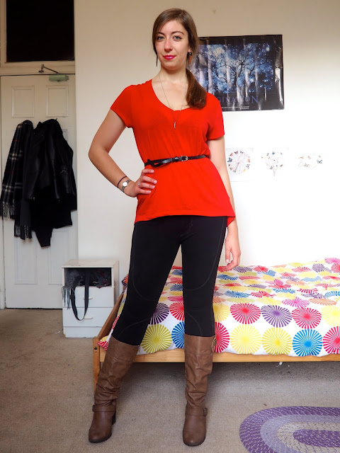 Disneybound Gaston inspired outfit of belted red top, black leggings and tall brown leather boots