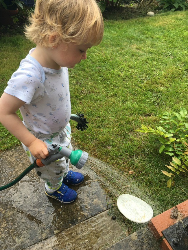 An-Indian-Summer-an-image-of-toddle-with-hose-pipe